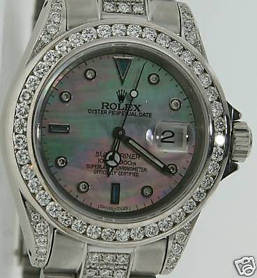ROLEX SUBMARINER MENS 7 CARATS OF DIAMONDS ALL OVER IT MOTHER PEARL DIAMOND DIAL