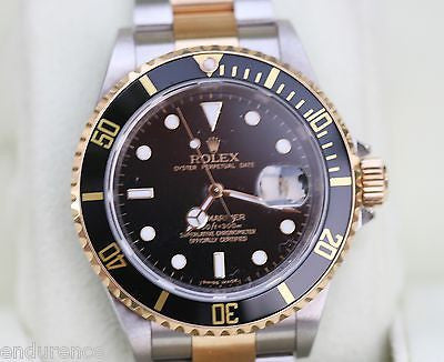 ROLEX SUBMARINER TWO TONE GOLD STAINLESS STEEL BLACK ON BLACK WATCH 16613