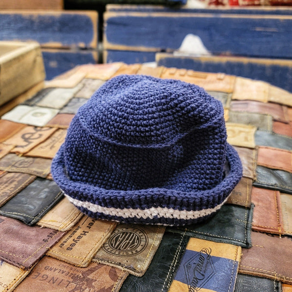 crocheted blue hat with white border stripe