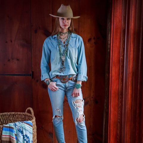 Cowgirl in light color denim shirt