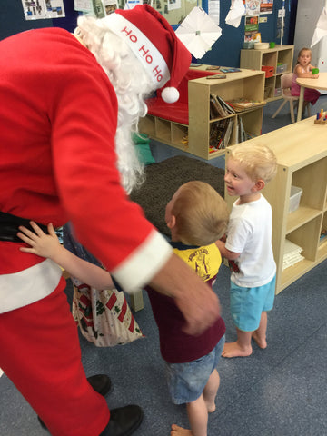Santa meets the Daycare Kids of Moreton Bay Region and they want him to buy a house on Bribie
