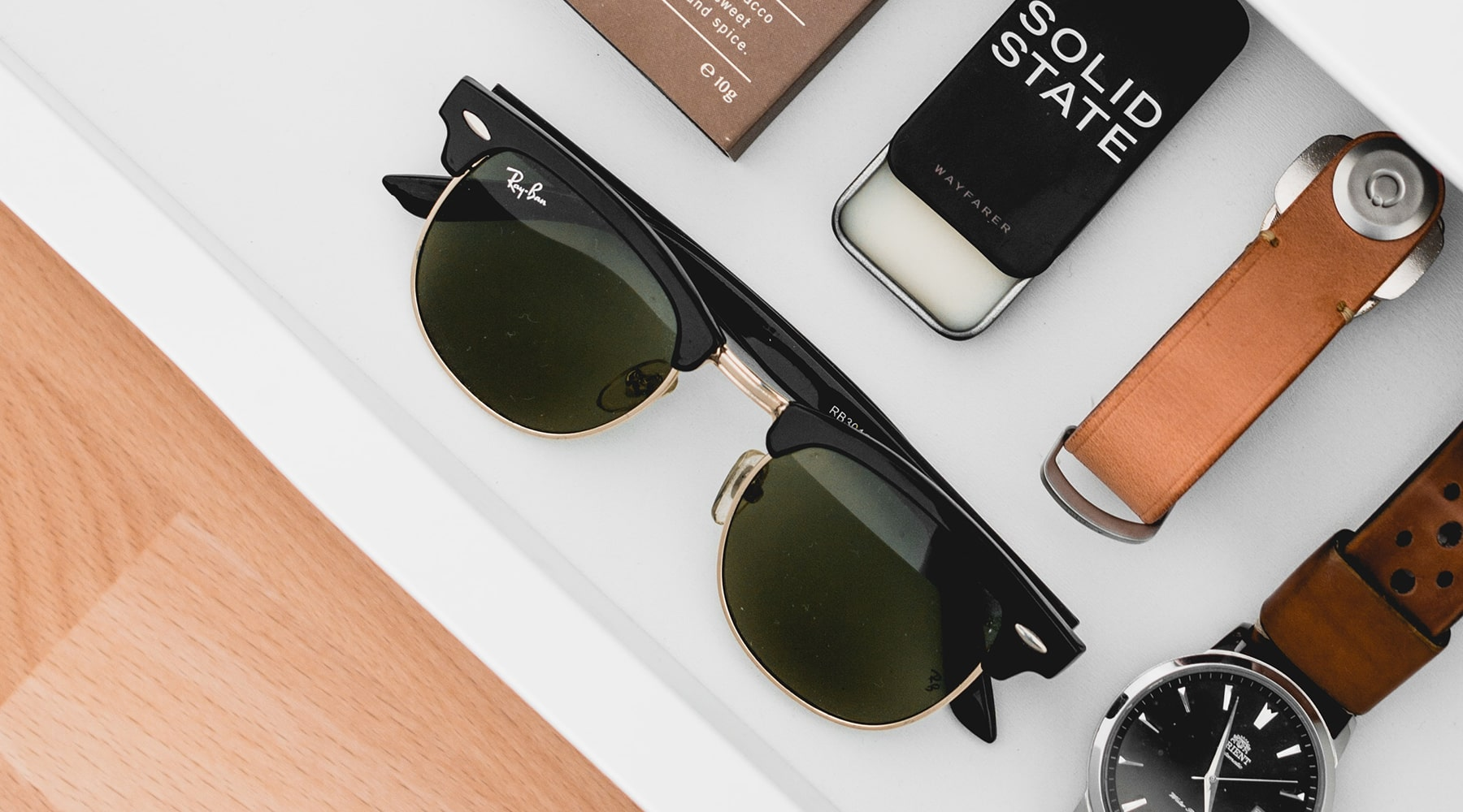 sunglass-flatlay-with-accessories