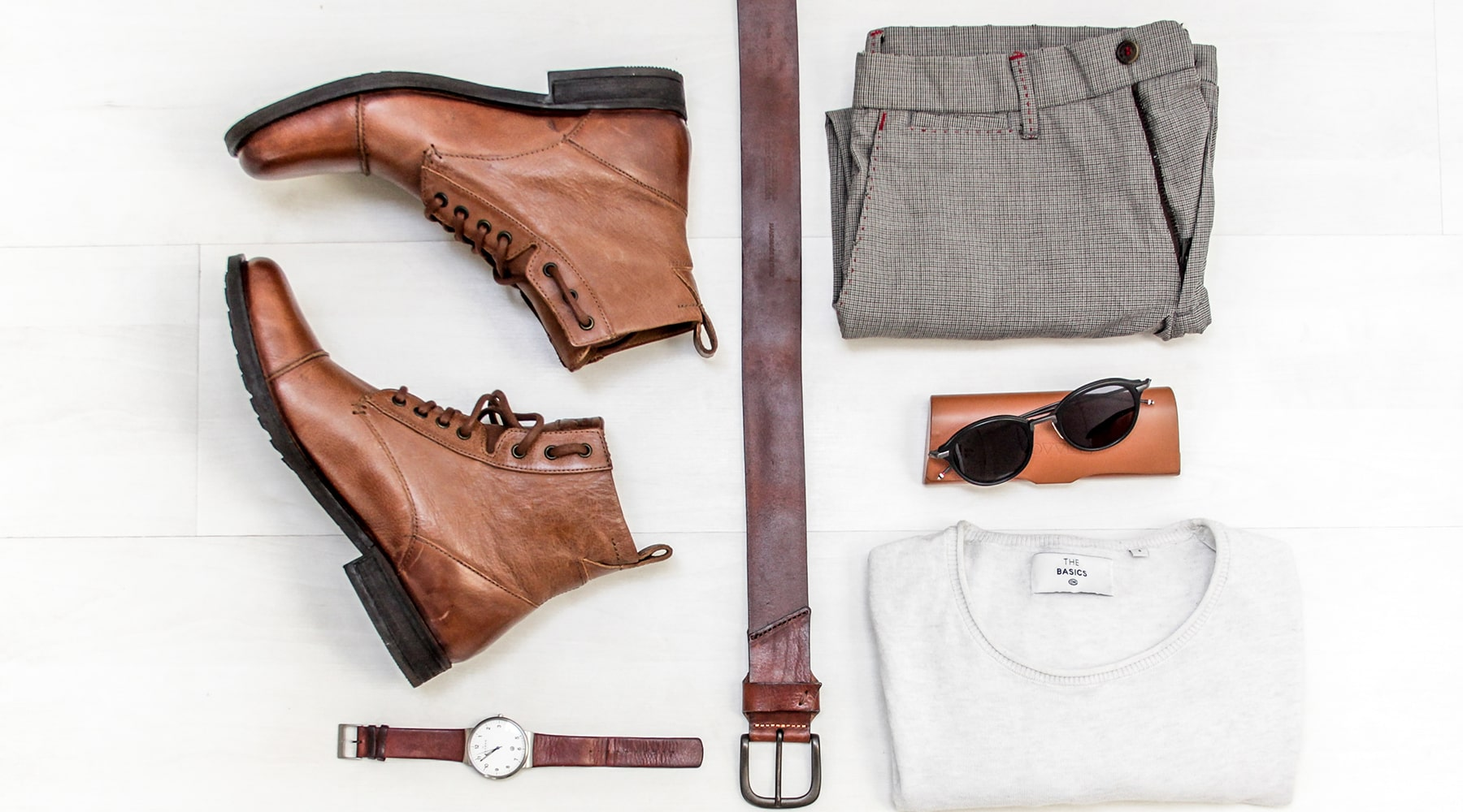 leather-belt-flatlay-with-accessories
