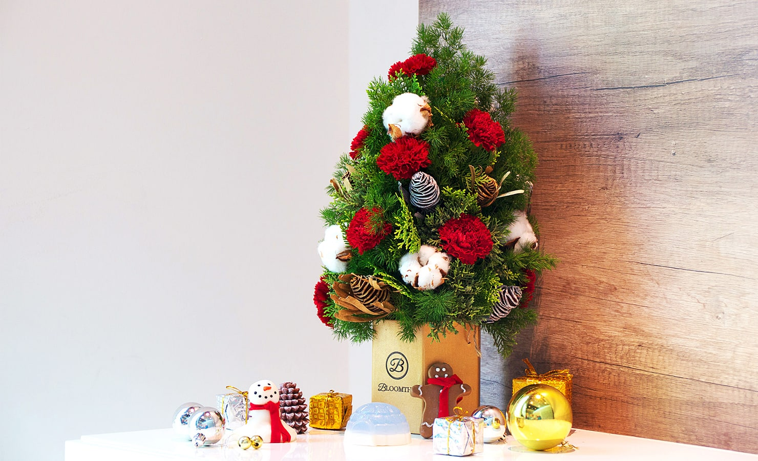 Create beautiful moments and enliven a special someone's home with BloomThis's Gabrielle. The adorable Christmas tree is just the right size to fit into ...