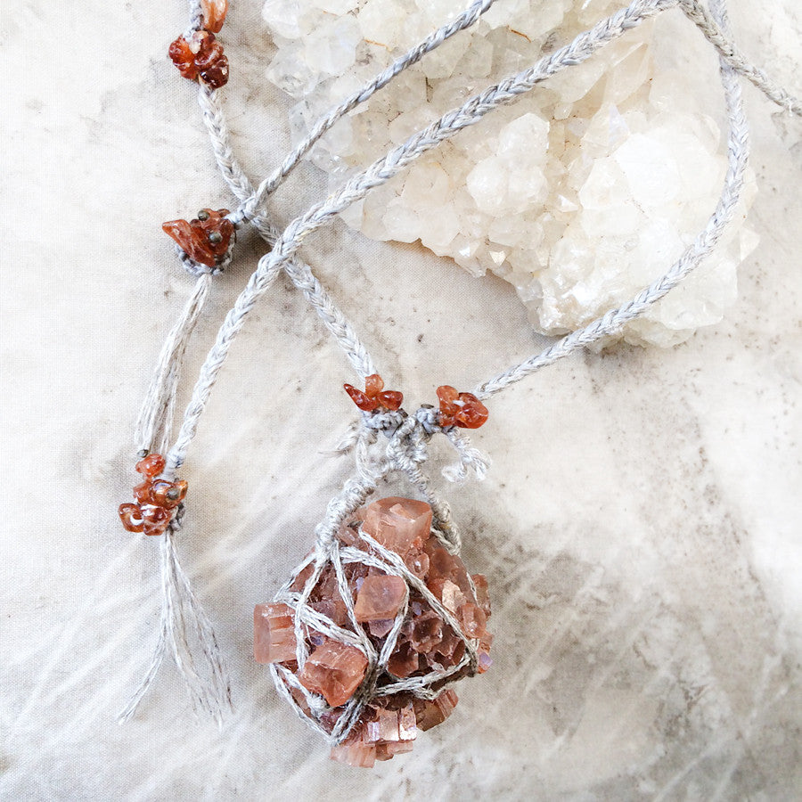 Stone talisman with Aragonite & Spessartine Garnet