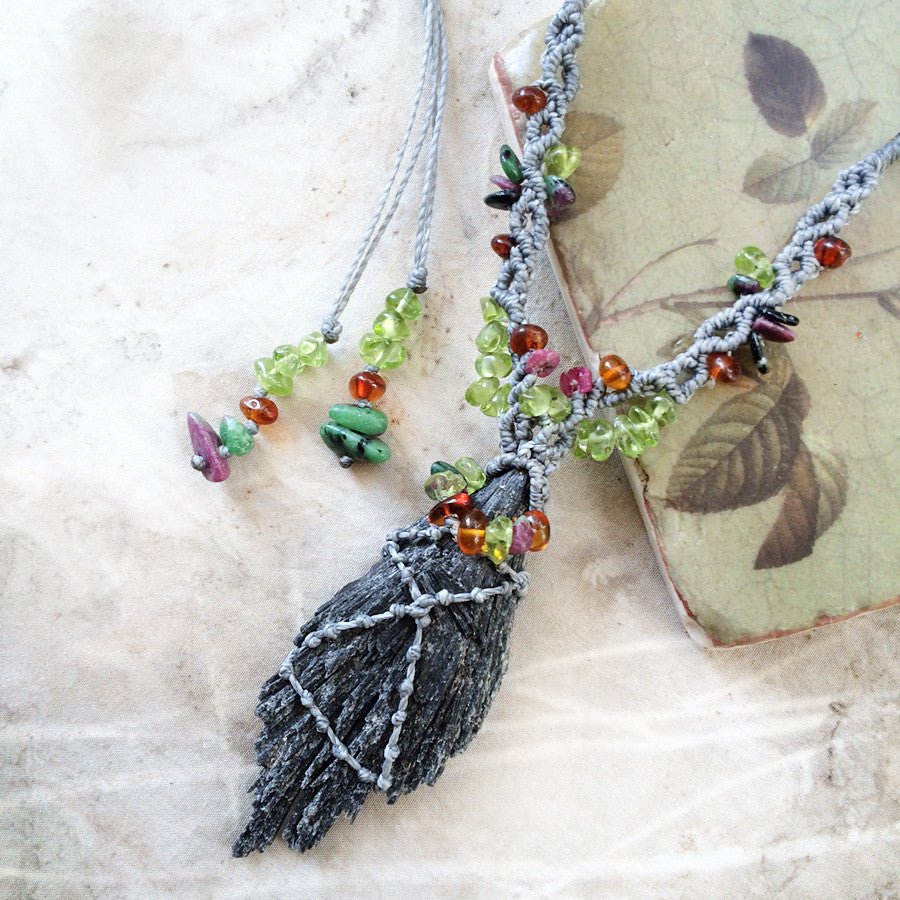 Black Kyanite crystal amulet with Peridot, Anyolite & Amber