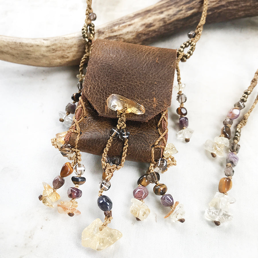 Tribal style leather pouch necklace with crystal detailing
