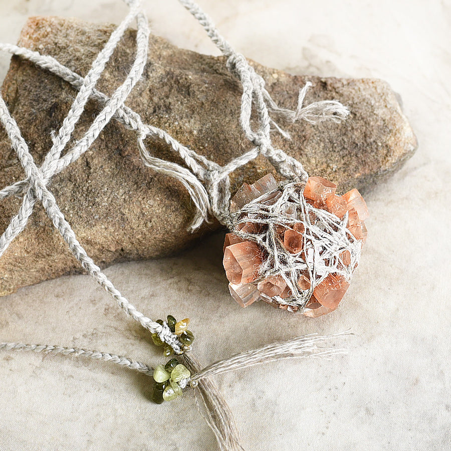 Aragonite crystal amulet with Verdelite in organic linen braid