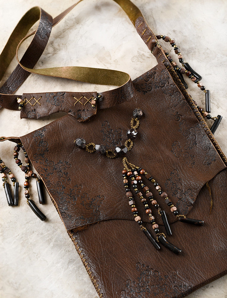 Tribal style dark brown leather bag, fully hand-stitched with crystal details
