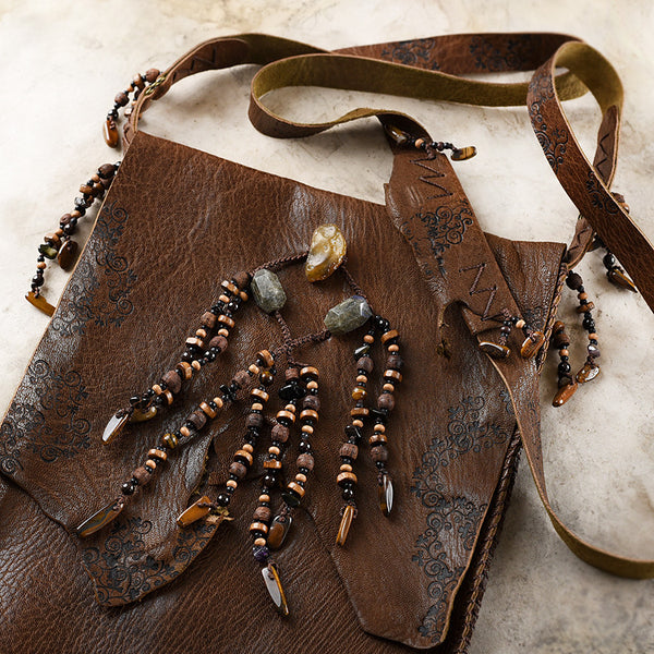 Tribal style brown leather bag, fully hand-stitched with crystal details