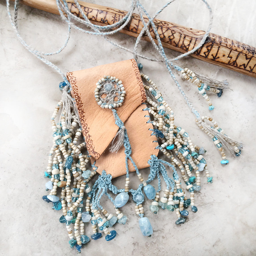 Tribal style wearable leather 'purse', fully hand-stitched with crystal details and beaded tassels