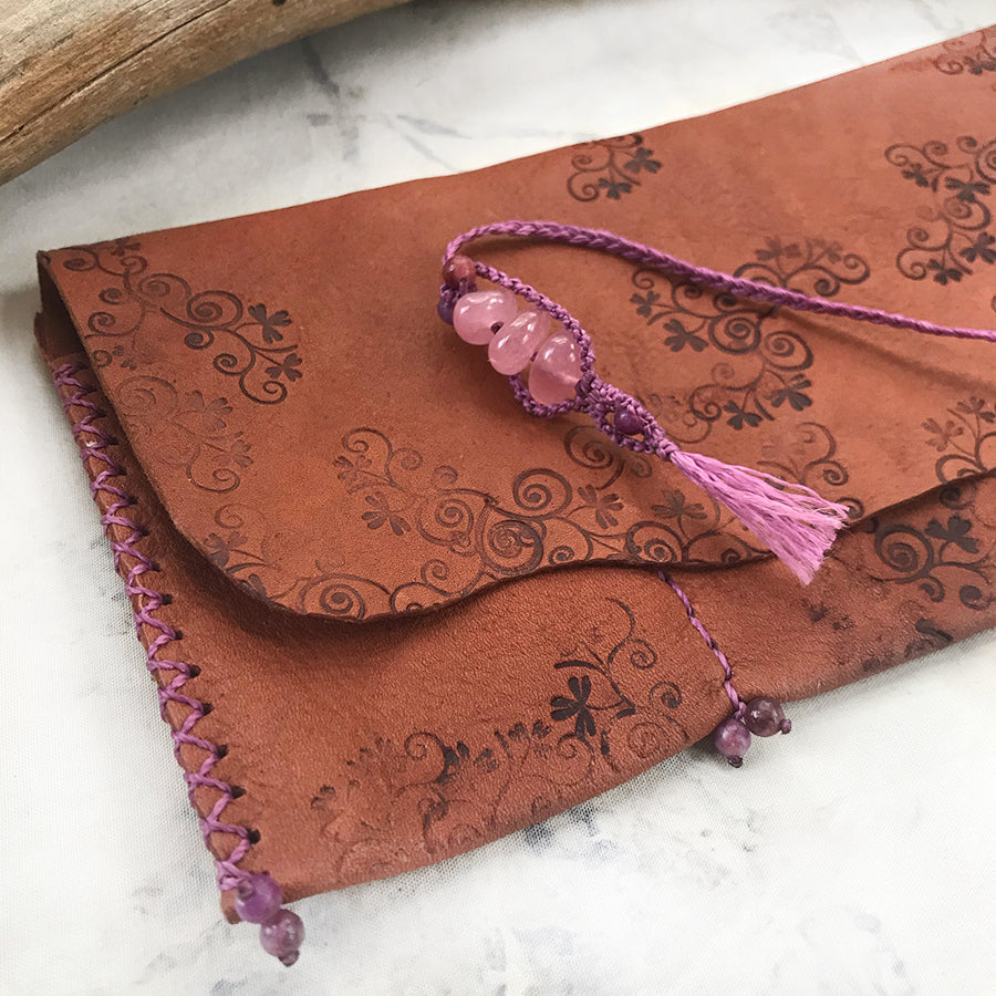 Tribal style leather roll for carrying crystal tools ~ with Rose Quartz toggle