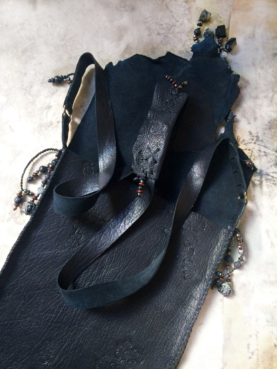 Tribal style black leather bag, fully hand-stitched with crystal details