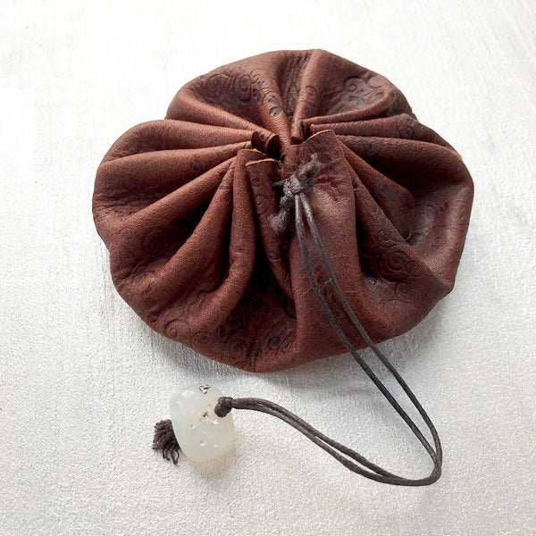 Drawstring leather pouch for carrying tiny treasures