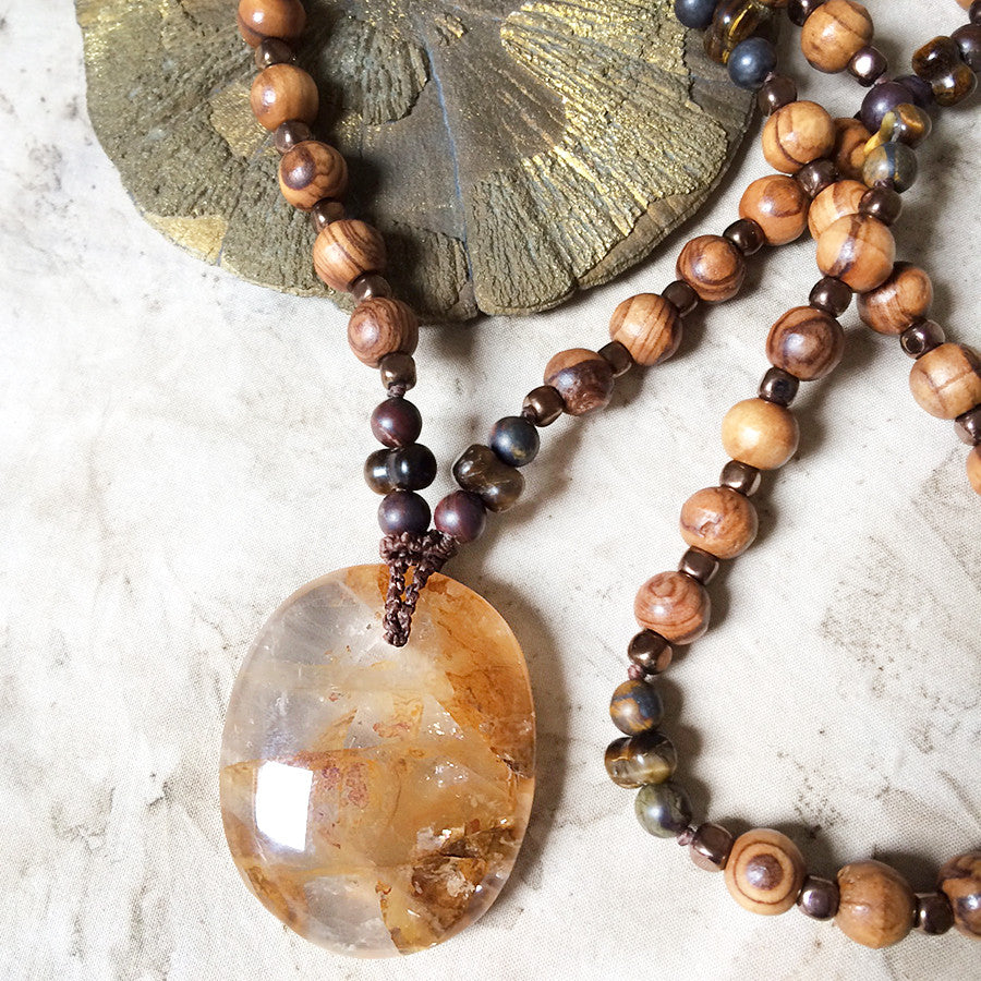 'Golden Healer' Quartz crystal amulet with Hematite, Tiger Eye, Tiger Iron & olive wood