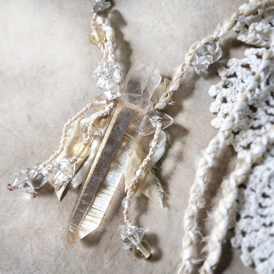 Crystal healing talisman with golden Lemurian Quartz in silk braid