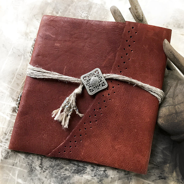 Small handbound journal with leather covers