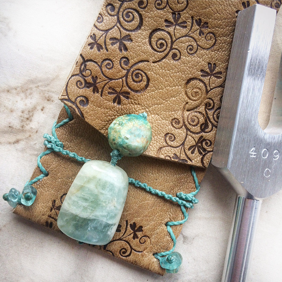 Crystal tuning fork in leather pouch with 'sounding crystal'