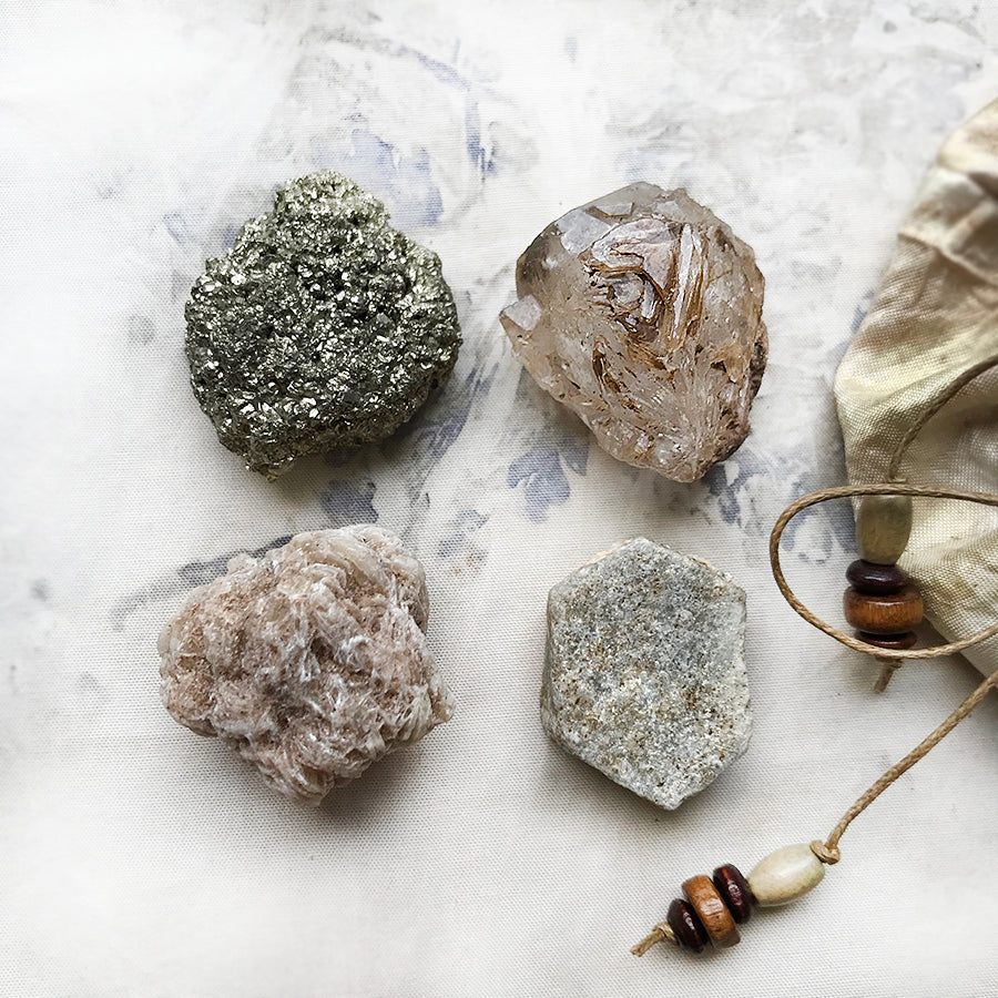 Crystal tribe of four: Yellow Sapphire, Fenster Quartz, Desert Rose & Pyrite