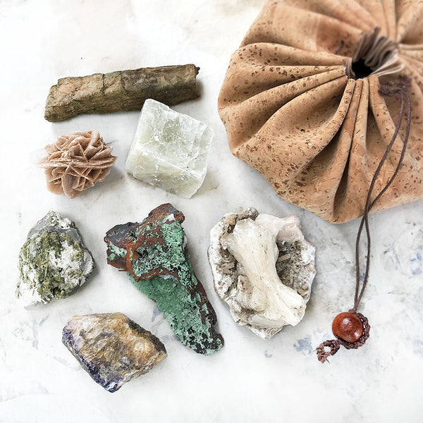 Seven rough crystals in a cork draw-string pouch