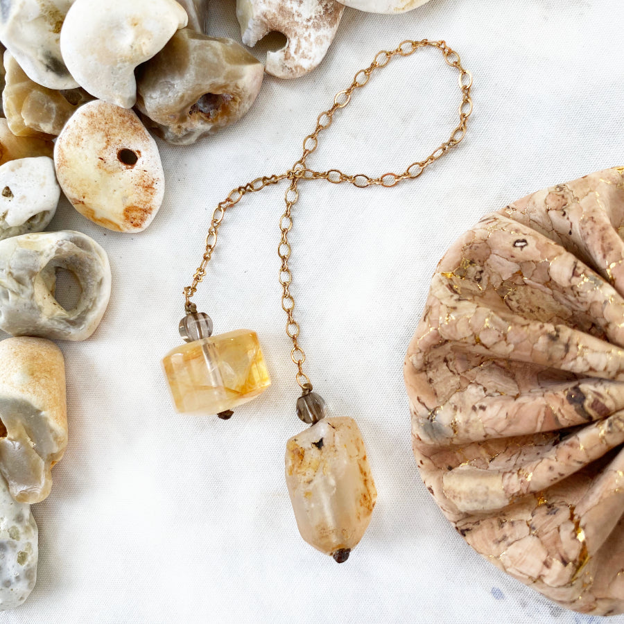 Pendulum with Topaz, Golden Healer Quartz & Smokey Quartz in cork pouch