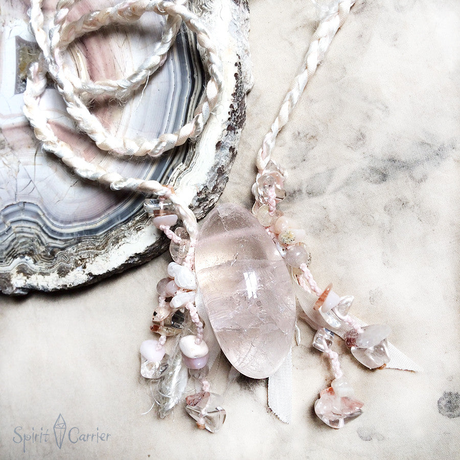 Stone talisman with pale pink Fluorite in soft silk braid