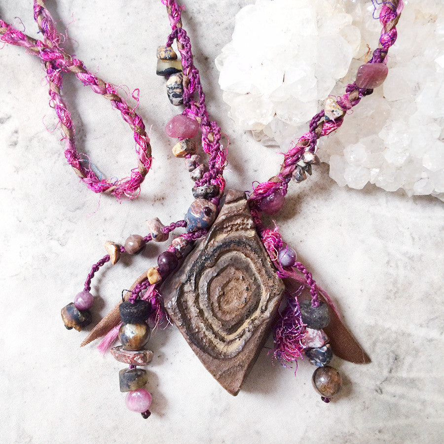 Shamanic desert stone talisman in silk braid