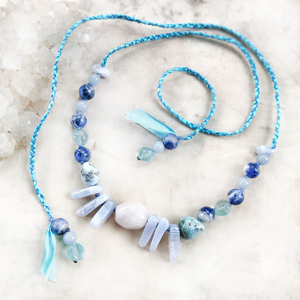Crystal healing amulet in gentle blue tones