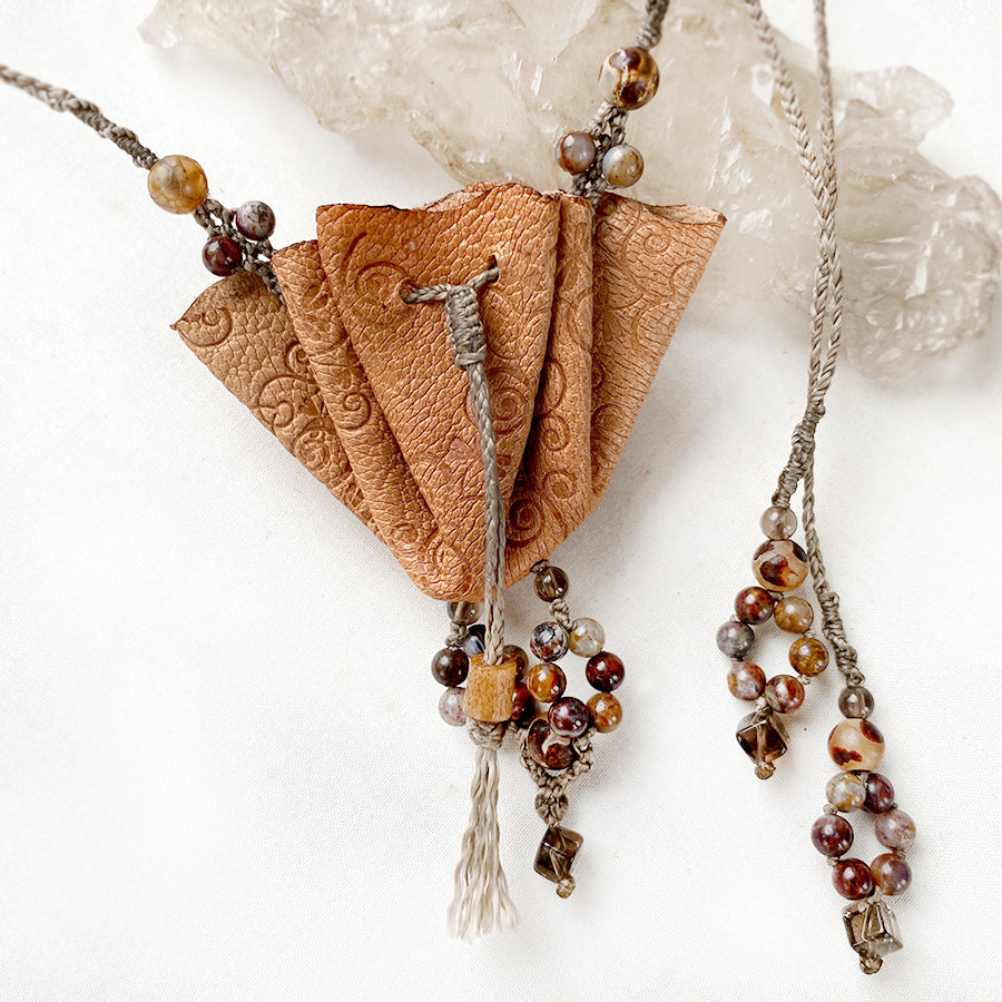 Small leather pouch necklace with crystal detailing