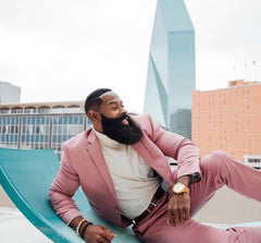 Man with long beard in a pink suit