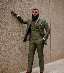 Man with biker beard in green suit