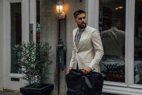Man with a beard wearing a suit