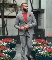 Black man in suit with red t shirt