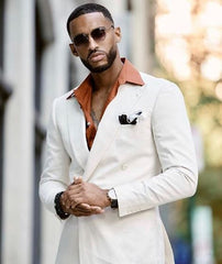 Black man in white suit