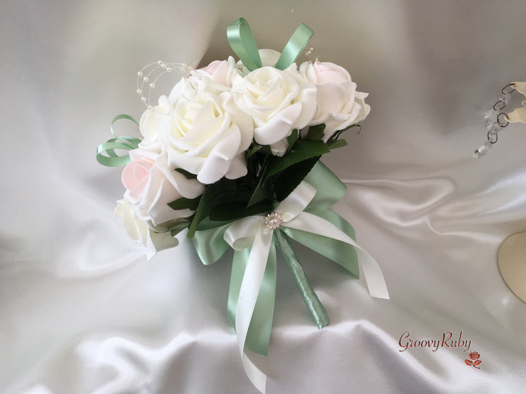 Blush Pink Centre & Ivory Roses With Sage Green Ribbon Loops, Pearl Loops & Brooches