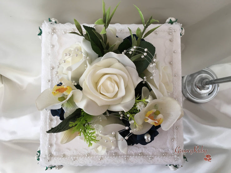 Ivory Orchids With Navy Roses, Foliage & Pearl Loops Cake Topper