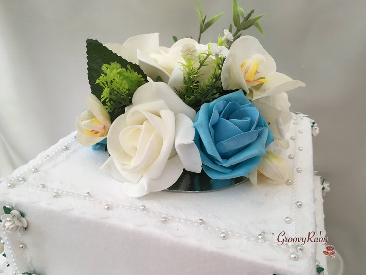 Ivory Orchids With Turquoise Roses & Foliage Cake Topper