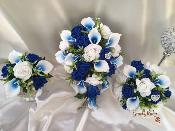 White Wedding Cake With Blue Lillies