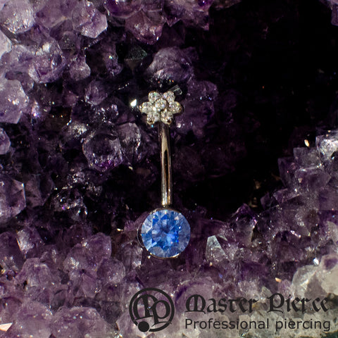 Artic Blue CZ Titanium Prong-Set Navel Curve with Clear CZ Flower Top