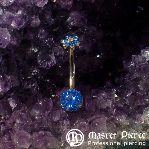 Artic Blue CZ Titanium Prong-Set Navel Curve with Flower Top