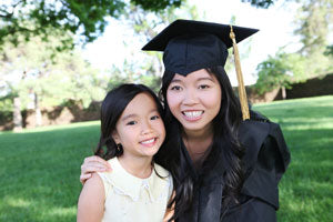 Young single mom celebrates graduation with daughter