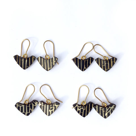 P R I N T E D . L E A T H E R . A R C . hook earrings