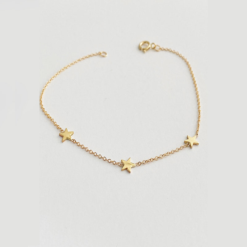 Three Baby Star Bracelet In Solid Gold