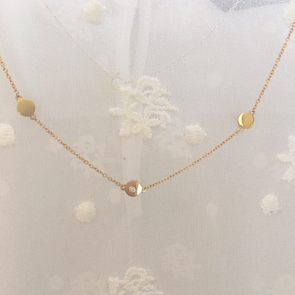 "In a world caught up in ""It's All about ""Me"" Here's a necklace that says ""It's  All about ""We""  Beautifully handcrafted in solid gold and accented with a freshly cut diamond.  A PORTION OF SALES ARE BEING DONATED TO WOMEN'S CHARITIES!!"