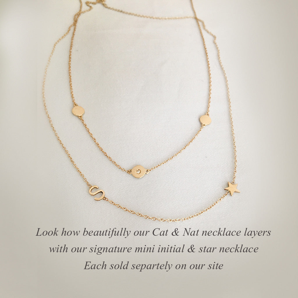 "In a world caught up in ""It's All about ""Me"" Here's a necklace that says ""It's  All about ""We""  Beautifully handcraftd in solid gold and accented with a freshly cut diamond.  A PORTION OF SALES ARE BEING DONATED TO WOMEN'S CHARITIES!!"