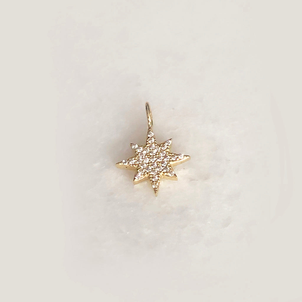 Solid Gold Starburst Cut Out Charm With CZ