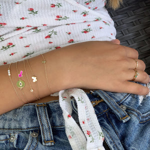 Shop The Look Solid Gold Diamond Hamsa Bracelet, Baby Butterfly Bracelet, Baby Delicate Diamond Bezel Bracelet Evil Eye Bracelet with a Black Diamond in the Middle & Opal Bar Bracelet
