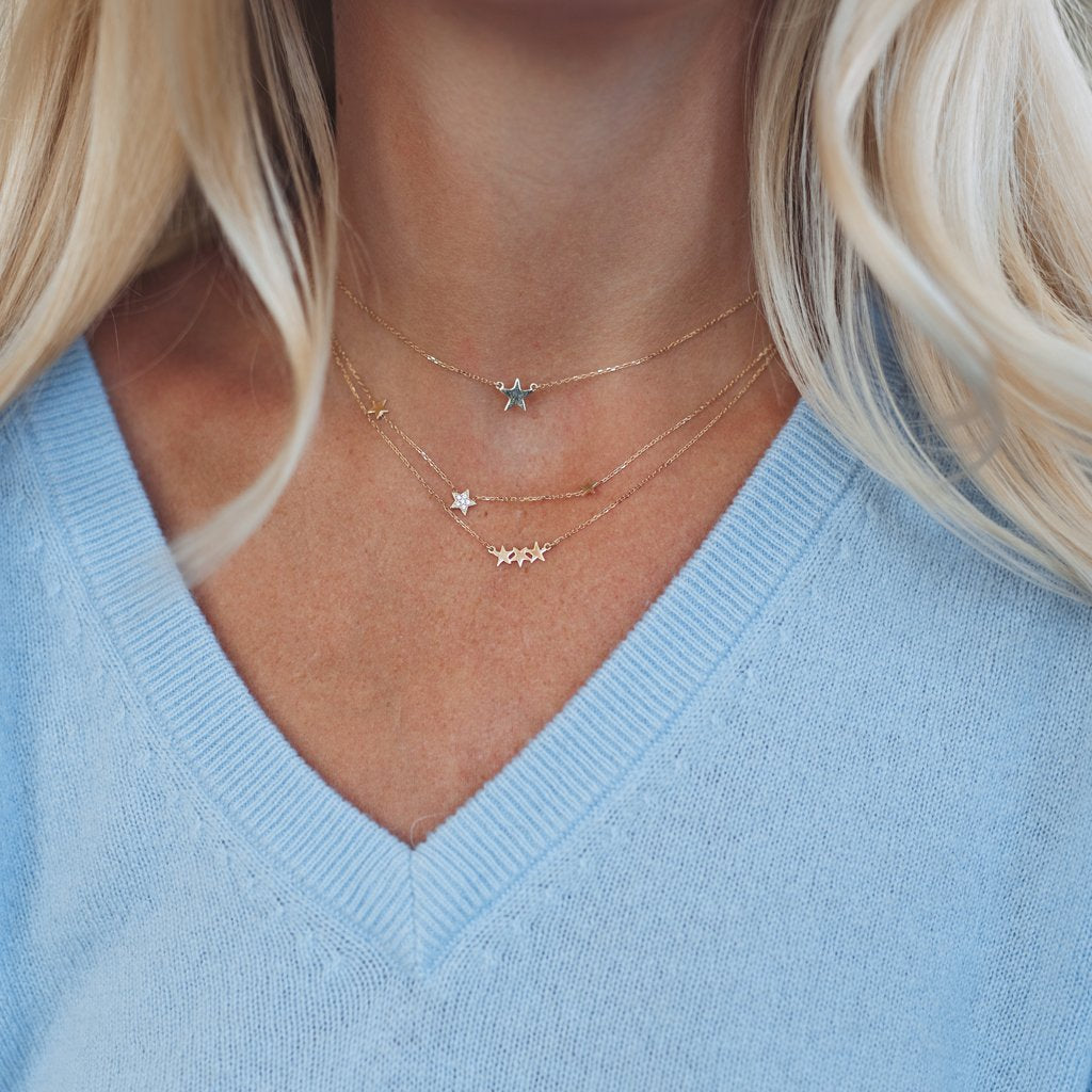 Shop The Look-  1. Baby Star Necklace. 2. Pave Star With Two Plain Gold Stars Necklace 3. Three Star Cluster Necklace- Each Sold Separately. All Solid Gold