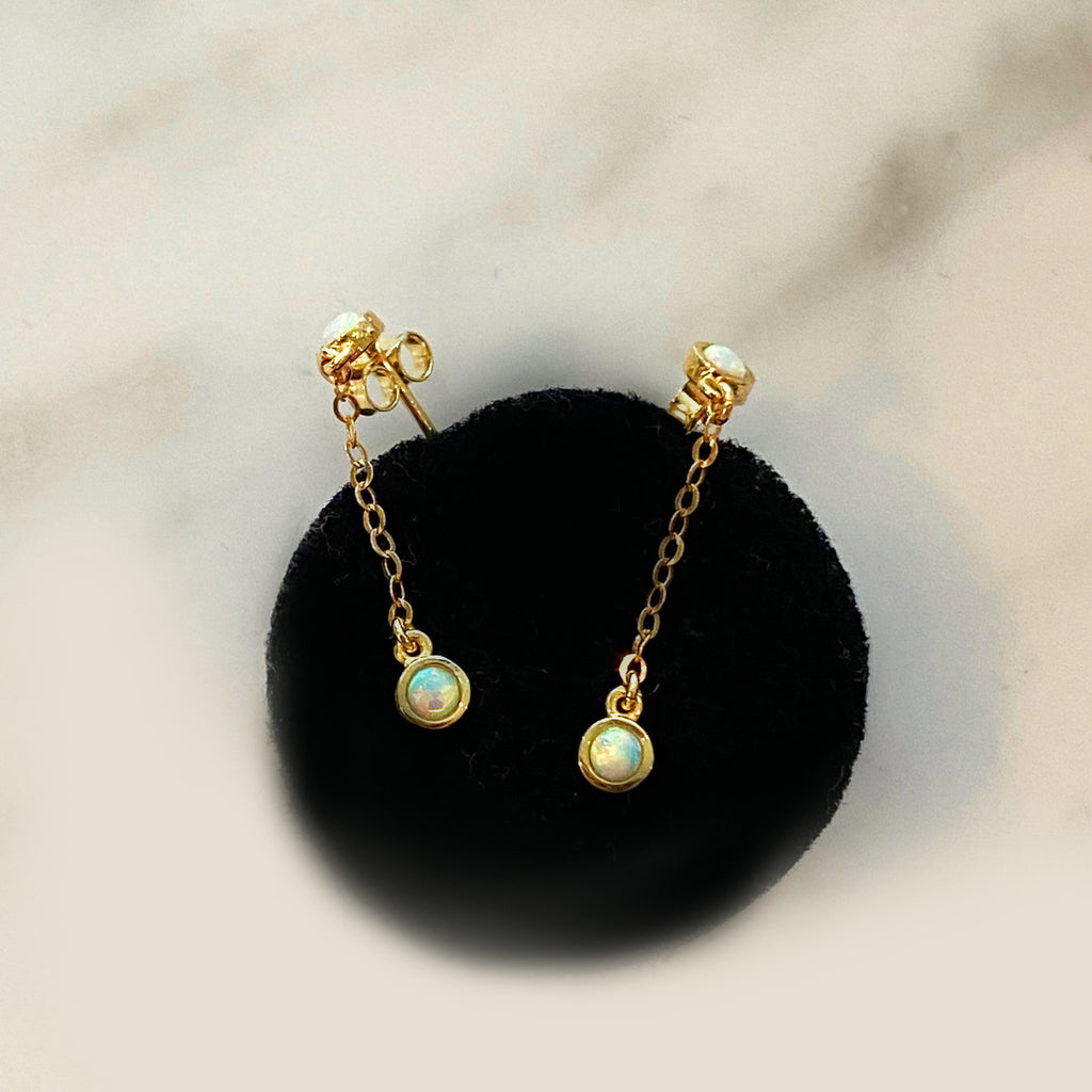 opal dangle earrings in sold gold