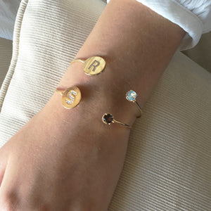 SHOP THE LOOK Initial disc cuff with beautiful gemstones